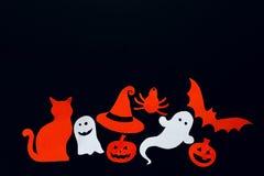 Fondo di Halloween con il fantasma, zucche, pipistrello, ragno, gatto e Immagine Stock