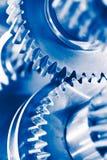 Fondo di industria con le ruote di ingranaggio blu immagini stock libere da diritti