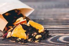 Fondo di legno del tè asciutto Sanità, alimento e concetto della bevanda Fotografie Stock