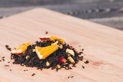 Fondo di legno del tè asciutto Sanità, alimento e concetto della bevanda Fotografia Stock