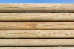 Fondo di legno della parete di Pali Fotografia Stock