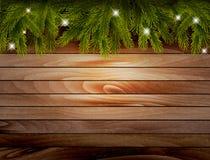 Fondo di legno di Natale con i rami e le bagattelle Immagine Stock