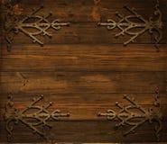 Fondo di legno di Natale decorato dall'ornamento di metallo di lerciume Immagini Stock