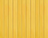 Fondo di legno di struttura della plancia colorato giallo Fotografia Stock