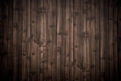 Fondo di legno di struttura della plancia di marrone scuro fotografia stock