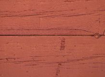 Fondo di legno rossastro di struttura con i modelli naturali fotografia stock