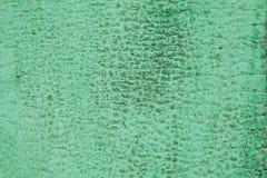 Fondo di legno stagionato verde con le crepe Fotografia Stock