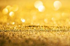 Fondo di lusso dell'estratto di scintillio dell'oro fotografia stock libera da diritti