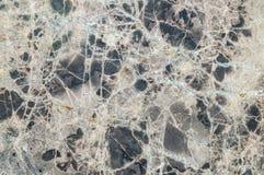 Fondo di marmo nero di superficie di struttura della parete del primo piano Fotografia Stock Libera da Diritti