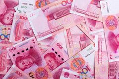 Fondo di molte 100 note cinesi di yuan di RMB Fotografia Stock