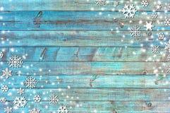 Fondo di Natale con i fiocchi di neve e la struttura di legno Immagine Stock Libera da Diritti