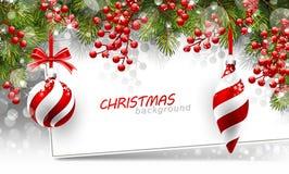 Fondo di Natale con i rami ed il rosso dell'abete Immagini Stock