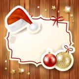 Fondo di Natale con l'etichetta ed il cappello Fotografia Stock Libera da Diritti
