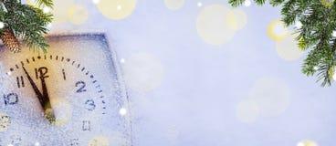 Fondo di Natale con l'orologio Immagine Stock