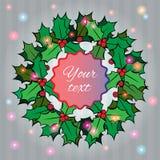 Fondo di Natale con la corona della bacca dell'agrifoglio Fotografie Stock