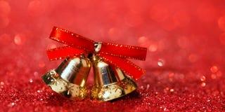 Fondo di Natale con le campane e lo scintillio Fotografia Stock Libera da Diritti