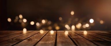 Fondo di Natale con le luci dorate per una decorazione Fotografie Stock