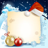 Fondo di Natale con pergamena, il cappello e le bagattelle Fotografie Stock