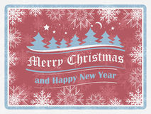 Fondo di Natale nel retro stile con i fiocchi di neve, la foresta e gli elementi decorati Scheda di nuovo anno felice Fotografia Stock