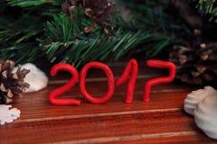 Fondo di Natale su legno regalo e caramelle gommosa e molle Immagine Stock
