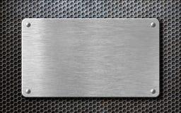 Fondo di piastra metallica d'acciaio spazzolato con i ribattini fotografia stock