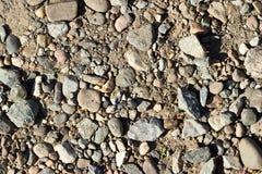 Fondo di piccoli ciottoli e sabbia immagini stock libere da diritti