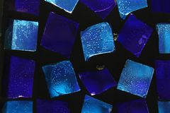Fondo di piccolo vetro blu Fotografia Stock