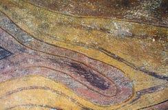 Fondo di pietra con struttura artificiale Fondo concreto rustico giallo e rosso Immagine Stock