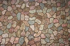 Fondo di pietra del muro di mattoni fuori della casa fotografia stock