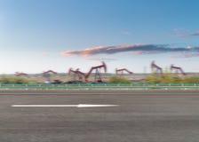 Fondo di pompaggio della macchina dell'olio e della strada fotografie stock libere da diritti
