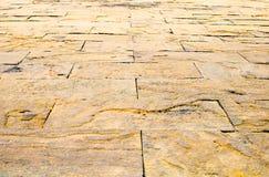 Fondo di prospettiva: Pavimento di pietra di prospettiva del mattone della sabbia, testo Fotografie Stock