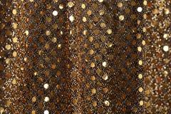 Fondo di scintillio dell'oro del nuovo anno di Natale Tessuto astratto di struttura di festa fotografia stock libera da diritti