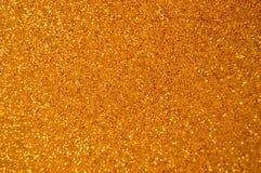 Fondo di scintillio dell'oro del nuovo anno di Natale Tessuto astratto di struttura di festa fotografie stock
