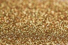 Fondo di scintillio dell'oro e dell'argento del nuovo anno di Natale Struttura astratta di festa fotografie stock
