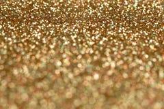 Fondo di scintillio dell'oro e dell'argento del nuovo anno di Natale Struttura astratta di festa Fotografia Stock