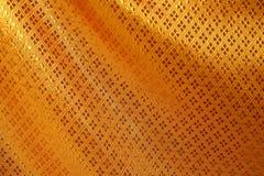 Fondo di seta dorato di struttura Fotografia Stock