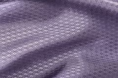 Fondo di seta, struttura della viola, tessuto brillante del modello del diamante Fotografie Stock