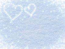 Fondo di Snowy con i cuori per il San Valentino fotografia stock