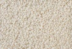 Fondo di struttura del riso del grano del risotto di Arborio breve nutrizione bio- Ingrediente di alimento naturale fotografia stock