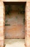 Fondo di struttura dell'entrata della parete di età della pietra fotografia stock