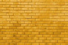 Fondo di struttura dell'estratto del muro di mattoni dell'oro giallo Fotografia Stock Libera da Diritti