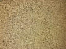 Fondo di struttura della parete colorato giallo, immagine stock