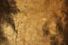 Fondo di struttura della parete dell'oro con l'attenuazione degli elementi immagine stock
