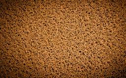 Fondo di tappeto arancio, ruspa spianatrice del piede, porta Immagini Stock