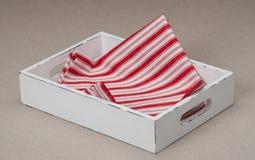 Fondo di tela naturale di Tray With Folded Napkin On Fotografia Stock