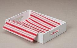 Fondo di tela naturale di Tray With Folded Napkin On Immagine Stock