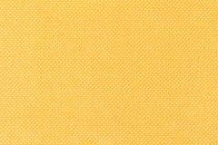 Fondo di tessuto giallo, struttura del materiale, fine su fotografia stock libera da diritti