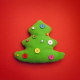 Fondo di Toy Christmas Tree On Red Fotografia Stock