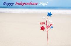 Fondo di U.S.A. di festa dell'indipendenza sulla spiaggia sabbiosa Immagine Stock Libera da Diritti