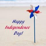 Fondo di U.S.A. di festa dell'indipendenza sulla spiaggia sabbiosa Fotografia Stock